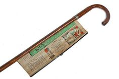 """Orange Bowl Map Cane-Circa 1940-An unusual souvenir from the 1940 Orange Bowl which includes a map of the stadium and the city, nice condition, metal collar, hardwood shaft and a metal ferrule-O.L. 35"""""""