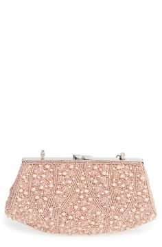 Sparkling pink beads highlight the elaborate design of this vintage-chic clutch topped with a polished kiss-lock closure.