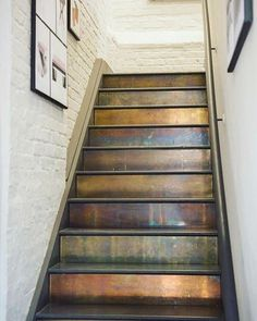 Um, now we wish we had stairs! - Patinated Brass Cladding on stairs.