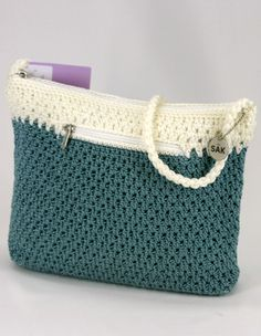 The Sak ivory and teal crochet handbag