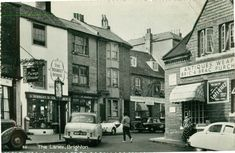 Postcard of Brighton Place, The Lanes. Sussex Postcards example postmarked Suspect by cars in photograph mid to 1959 Brighton Lanes, Brighton East Sussex, Brighton Rock, Brighton England, Brighton And Hove, 1960s Britain, Great Britain, Postcard Examples, Seaside Shops