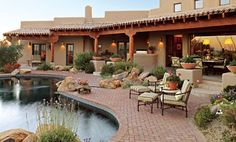 A pueblo-style home features a gorgeous patio and pool, offering front-row seats to stunning Arizona sunsets. - Traditional Home®  Photo: Michael Venera Design: Patty Burdick
