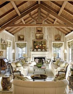 In Nancy and Bill Morton's Florida home, the living room's pecky-cypress paneling was lightened by decorative painter Bob Christian, whose work can also be seen on the tile fireplace surround. The landscape paintings are English, the roll-arm Architectural Digest, Architectural Sketches, Fireplace Tile Surround, Fireplace Surrounds, Florida Villas, Florida Home, Florida Living, Pecky Cypress Paneling, Barn Living