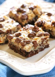 These German Chocolate Cake Bars are all the flavors of your favorite cake in a bar! Awesome dessert recipe!