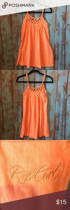 NWOT Rip Curl sun dress size medium NWOT! Boughten then forgotten! Purging closets and selling! 😊 Super cute Rip Curl sun dress! Size medium! Very pretty creamy orange color! No trades! Rip Curl Dresses Midi