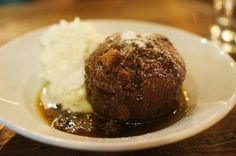 BLACK MISSION FIG STICK TOFFEE PUDDING (plated with a generous dollop of whipped cream.)