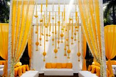 Looking for Mehendi yellow mandap seating idea? Browse of latest bridal photos, lehenga & jewelry designs, decor ideas, etc. on WedMeGood Gallery. Desi Wedding Decor, Wedding Hall Decorations, Marriage Decoration, Wedding Mandap, Lilac Wedding, Wedding Ideas, Wedding Planning, Wedding Story, Trendy Wedding