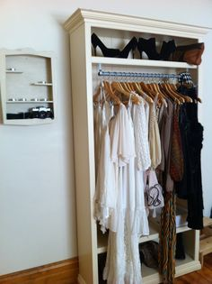 Wardrobe - perfect for in the basement for off season clothing or special clothes in hanging bags to free up closet space!