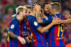 Lionel Messi (L) of FC Barcelona celebrates with his teammates (L-R) Denis Suarez, Munir El Haddadi, Arda Turan and Lucas Digne after scoring his team's third goal during the Spanish Super Cup Final second leg match between FC Barcelona and Sevilla FC at Camp Nou on August 17, 2016 in Barcelona, Catalonia.
