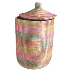 With its lively zigzag pattern, the Ular pink seagrass laundry basket with lid combines functionality with distinctive design. Handwoven in Vietnam; the basket's pretty colour palette makes it an attractive addition to a bedroom, bathroom or utility room. Laundry Basket With Lid, Uk Homes, Zig Zag Pattern, Bath Accessories, Habitats, Hand Weaving, Pink, Vietnam, Design