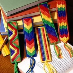 Bright and colorful bookmarks with various easy stitches. The designs are stitched using worsted weight yarn and 7 mesh plastic canvas.  This is a digital download product from Leisure Arts