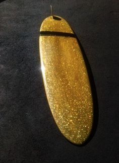 Gold glitter surfboard (very Duck Drake)