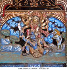 Hindu Goddess Chamunda fighting with demon Mahisha. Sculpture on the wall of ancient Durga temple