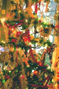 Anything can be used to decorate a tree. When tinsel and Christmas tree lights are added for some reason it looks like Christmas!