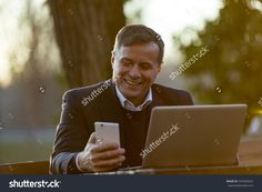 senior business man working outdoors always connected with his smartphone and his loyal laptop