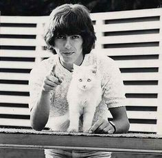 george harrison & a fabulous cat.  John esp, & George & Paul were Cat-People. I saw a pic of Ringo with a baby lion on his lap!  Maybe that's what he preferred...