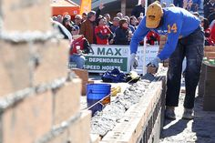 Competitors raced to lay the most bricks during the Spec Mix Bricklayer 500 World Championship inside the Masonry Madness Arena set up outside the Las Vegas Convention Center on Wednesday.