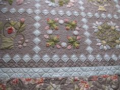Carrie  posted today about her Hop To It  quilt so I will now show a few pictures on my blog of the quilting I did for her.    She reques...