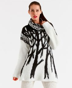 Interestic black and white, modern and abstract inarsia work with cable collar and corresponding tops of sleeves.