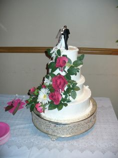 I like the flowers that climb.  Use the flowers from the wedding and climb?   3 tiers at most