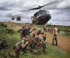 Australian soldiers wait to be picked up by American helicopters in South Vietnam, August 1967