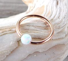 Captive White Fire Opal Bead Septum,Upper Ear Daith Rook,Tragus,Cartilage Hoop Earring,Nose Ring,Eyebrow Piercing,14K Rose Gold Filled 18 Gauge-10mm null http://www.amazon.com/dp/B01BMTEJ9U/ref=cm_sw_r_pi_dp_-z4Uwb1CA74PA