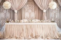 Say hello to the #headtable of our dreams! We absolutely love the muted, monochromatic neutral colour palette- from the table linens to the backdrop draping and the #flowers- not a single detail was overlooked! Repost, Toronto's: @have_a_seat_decor