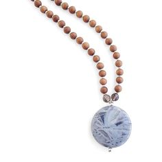 *Flower Agate, Smoky Quartz, Lepidolite*  You embrace new experiences, exposing your family to all that the world has to offer. The Adventurous Mama Mala supports your desire to travel, explore and embrace this wondrous life.