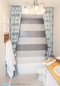 hang a shower curtain higher to deemphasize the soffit and add a little drama