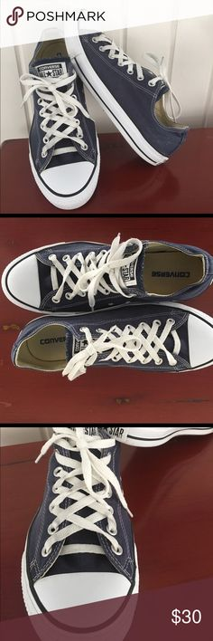 Converse All Star Men's 10 Navy Men's 10 or Women's 12 in great condition.  Express yourself in iconic fashion with the Converse Chuck Taylor All Star. Long seen as a celebration of personal style, this classic shoe features the popular brand logo on the tongue and a low-top construction. The durable canvas upper allows for a secure fit, while the traditional lacing design improves lockdown. Contributing to this sneaker's lasting resilience is the vulcanized rubber outsole, which has defined…