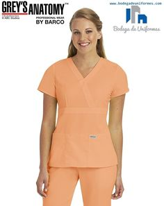 Grey's Anatomy mock wrap top features 3 patch pockets and adjustable tabs on the back for a custom fit. Healthcare Uniforms, Medical Uniforms, Grey's Anatomy, Lab Coats, Medical Scrubs, Nursing Clothes, Dress Codes, V Neck Tops, Work Wear
