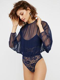 Mama Jen Bodysuit | Floral lace bodysuit featuring adjustable straps and snaps at the gusset. Sheer chiffon blouse overlay featuring dolman style sleeves and a high rounded neck. Open back with delicate button closures at the top.