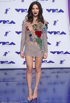 She sparkles! Olivia Munn showcased her fantastic figure in an embellished Nicolas Jebran dress at Sunday's VMAs while gave onlookers a generous look at her long legs and curvy chest