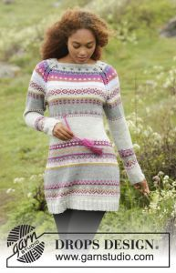 DROPS dress with multi-colored pattern, raglan and twined string with tassels in waist, worked top down. Free knitting pattern. Pattern category: Dresses. DK weight yarn. 1200-1500 yards 1500-1800 yards 1800-2100 yards 2100 + yards. Features: Colorwork, Long Sleeve, Raglan, Seamless, Top-Down. Experienced difficulty level.