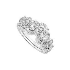 Beautiful design with center hold a bigger prong-set round diamond and both side with heart shape accented by sparkling brilliant-cut diamonds along with matching wedding band to make a perfect sets of ring. Made in 14K white gold & has a total diamond weight (TDW) of engagement ring 0.55 carat and wedding band as 0.20 carat...Please note: Normal shipping time is for the average ring size (Women - size 6, Men - size 10). If you order a different size, the ring will be custom