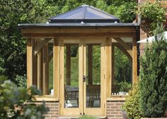 Beautiful oak orangery extension with a glass lantern and French doors.