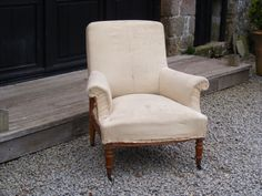 Chair with Square top covered in calico with casters on front.   Height: 88cm  Width: 80cm  Depth of seat: 50cm