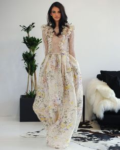 """Gown in """"Wildflower"""" silk organza with full skirt, ruffled details and nude Chantilly lace bodice and long sleeves."""