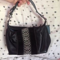 1/5 HOST PICKAuthentic small coach purse Small authentic coach purse! black with black felt and grey and black coach signature print. Cute blue inside. Pre loved but still good condition! Make an offer!!  Best in bags host pick 1/5☺️ Coach Bags