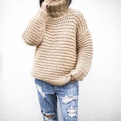 Pullover with ripped jeans