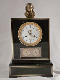 "Clock ""borne"" in blackened #pearwood and #bronze. Rare movement with three dial-plates. The main dial-plate indicates the hours in Arabic numbers. The other two indicate the day of the week and the date. Beautiful #french #varnish. A bronze sculpture of a religious overcomes the room. Early #19th century. For sale on Proantic by Galerie de Fontaine."
