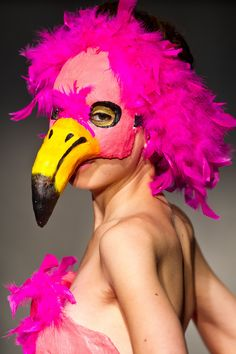 A model wears a bird mask for the Angela Balderston for Get Plastered line during Omaha Fashion Week.  By: CHRIS MACHIAN/THE WORLD-HERALD