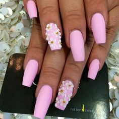 Pink coffin shaped nails with decorating flowers