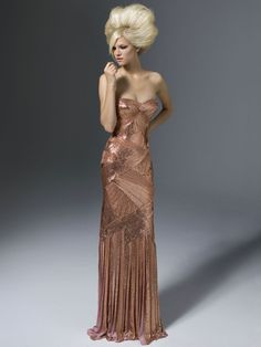Can't afford it, have no where to wear it but it simply takes my breath away.
