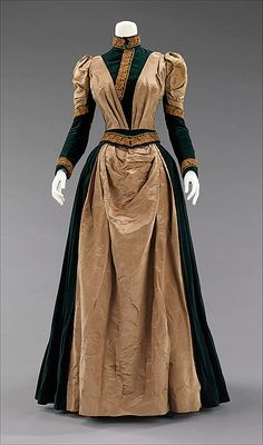 1885 Afternoon Dress  Culture: American  Medium: silk  The passementerie on this elegant dress is clearly influenced by the Arts and Crafts design aesthetic which was extremely popular 1880 and 1910. This is an excellent example of how a movement which is mostly based in architecture and interior design crept into clothing, showing the proponents' desire to live the style in its entirety.