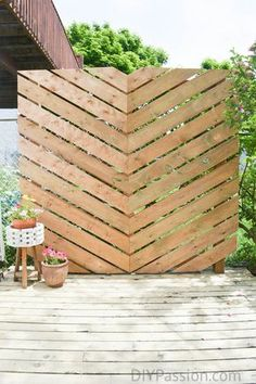 Build a cool outdoor privacy wall for less than $150! http://www.diypassion.com/2016/07/28/build-simple-chevron-outdoor-privacy-wall/?utm_campaign=coschedule&utm_source=pinterest&utm_medium=DIY%20Passion&utm_content=How%20to%20Build%20a%20Simple%20Chevron%20Outdoor%20Privacy%20Wall