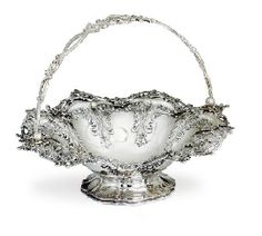 A VICTORIAN SILVER CAKE BASKET MARK OF JOSEPH AND JOHN ANGELL, LONDON, 1845 Shaped circular, on circular scalloped foot, the body decorated with repoussé work of scrolling foliage, the rim pierced at intervals, with an overhead swing handle pierced and chased with scrolling foliage and vacant cartouch