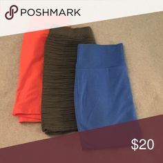 Bundle of Bodycon Skirts Peach colored one has never been worn, blue and gray have each been worn once. They're all in great condition. Blue and peach are both size small, gray is size medium Skirts Mini