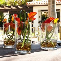 Mini Calla Lily Centerpieces in mango, set of 3 from Costco, 120 shipped.  Coulr recreate with sea glass in the vase instead of the crystals.