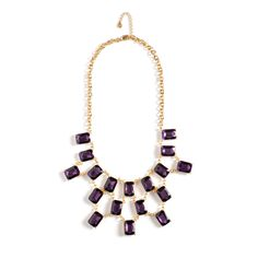 The Geena necklace is absolutely luxurious. Geena's gold chain bib style envelops a sea of rectangular crystals in deep, shimmering purple. You'll turn heads adorned in this dramatic and regal statement-maker. $88